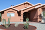 Front view of Villa. Professional desert landscaping in modern Santa Fee Style
